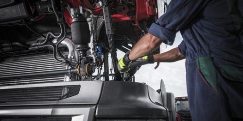 Repairing Broken Semi Truck Tractor Engine. Caucasian Trucks Mechanic.